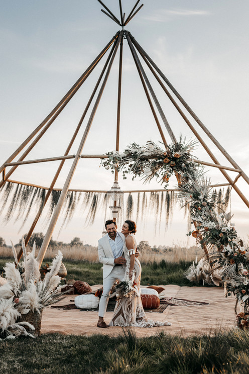naked tipi decorated with dried flowers at wilderness weddings venue in kent