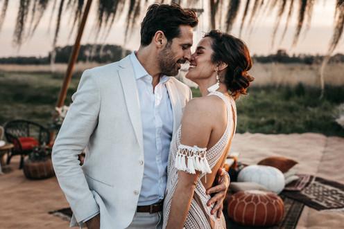 boho style bride and groom at wilderness weddings venue in kent