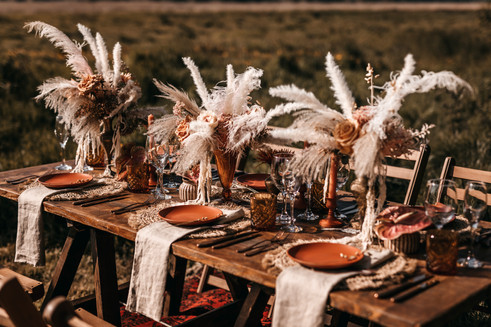 outdoor boho wedding reception table with dried flowers