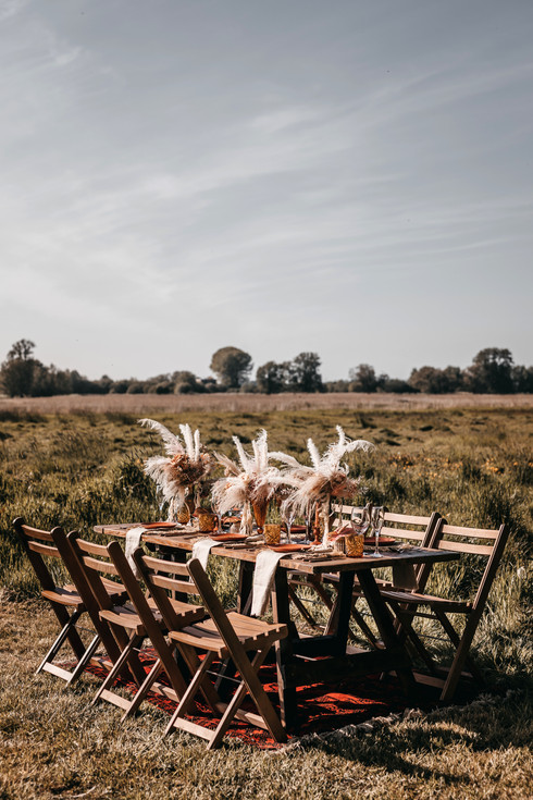 outdoor wedding reception table with dried flowers