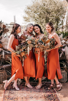 rust coloured bridemaid dresses and dried flowers