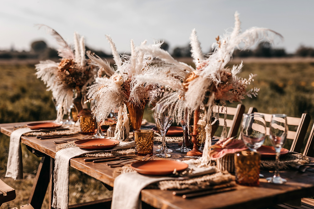 bohemian outdoor wedding reception table with dried flowers
