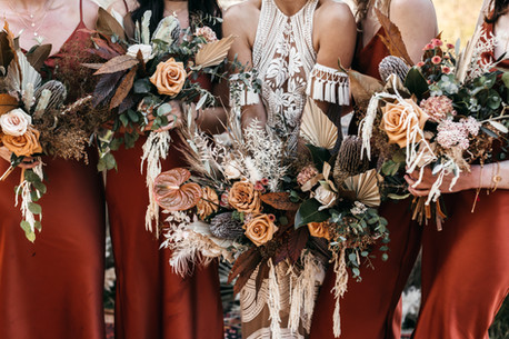 rust dresses with dried flower bouquets