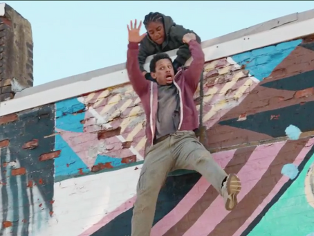 Tiffany Haddish dangles Eric Andre over a roof in 'Bad Trip'
