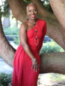 Jamie red dress standing by tree IMG_658