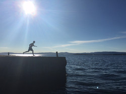 Jumping in the autumn fjord in my hometown of Nesodden Norway on Flaskebek brygge