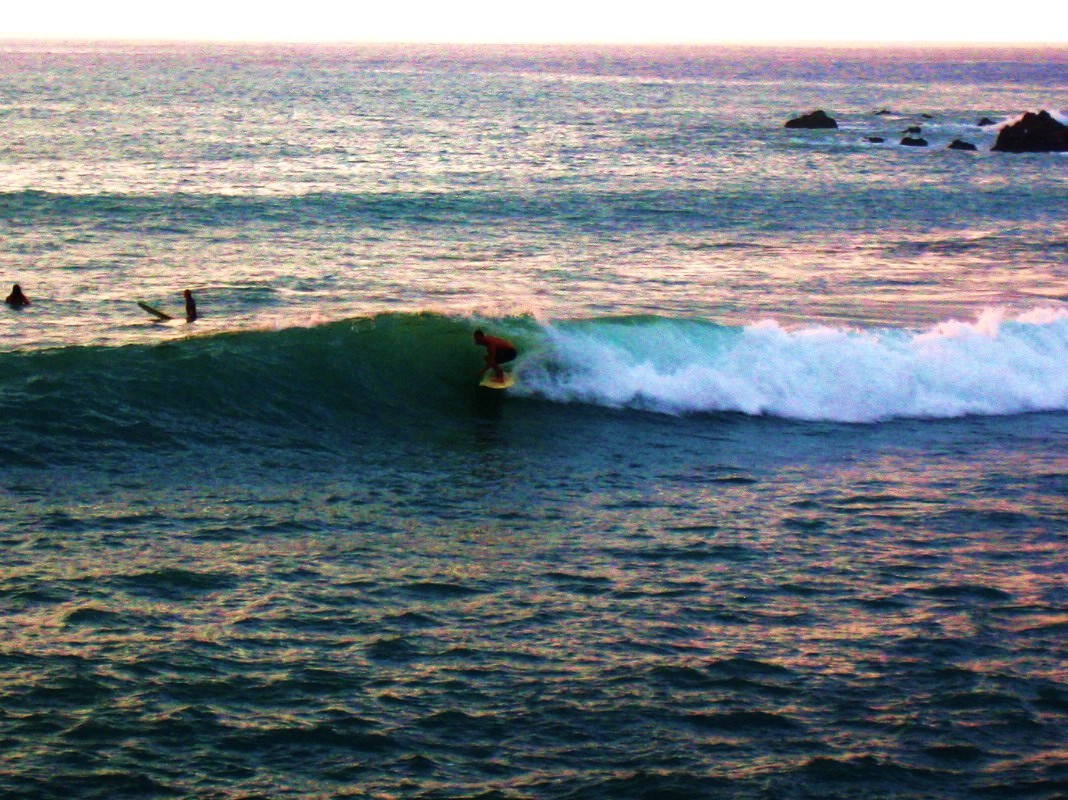 Surfing at Beach 69, Big Island HI.