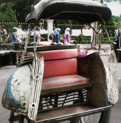 A lonely becak bicycle taxi waits for a passenger in Yogyakarta, Java, Indonesia