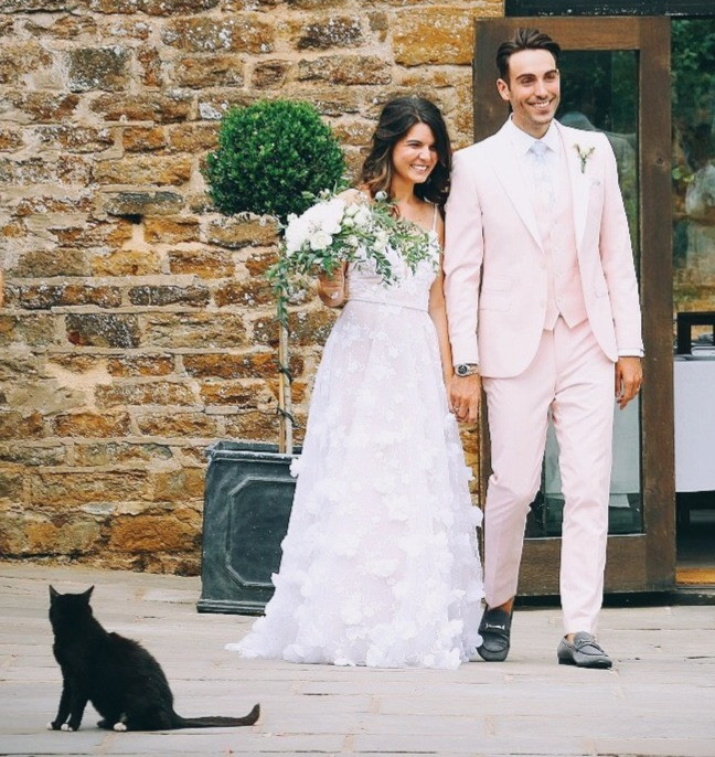 Black cat crosses the path of newly wedded couple