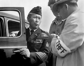 Japanese-American veteran, dressed in hi