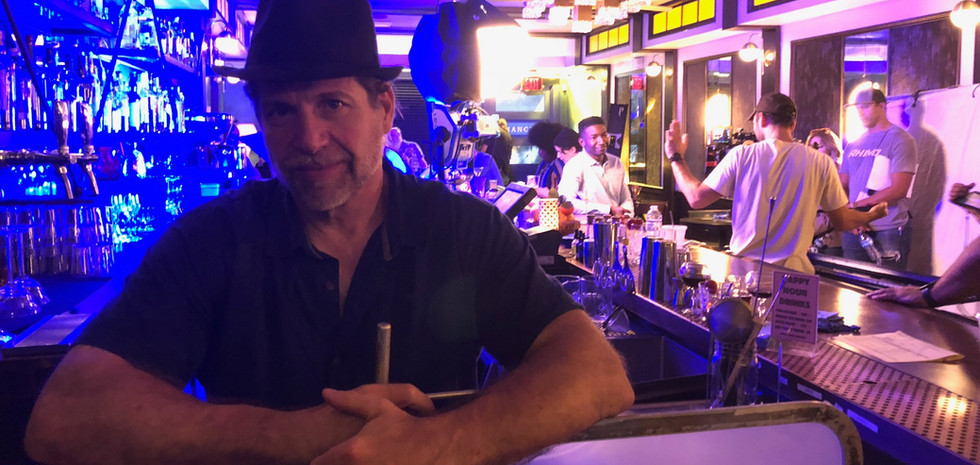 Producer Ed Polgardy relaxes as the camera crew sets up a candy-colored shot on OH JEROME, NO.