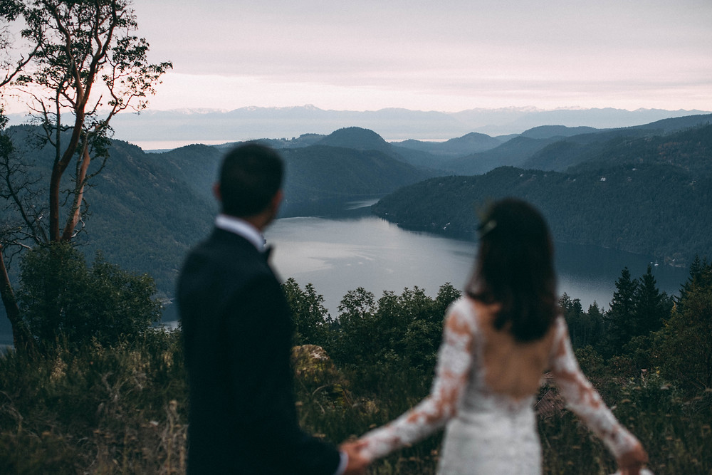 Couple overlooking beautiful view while holding hands