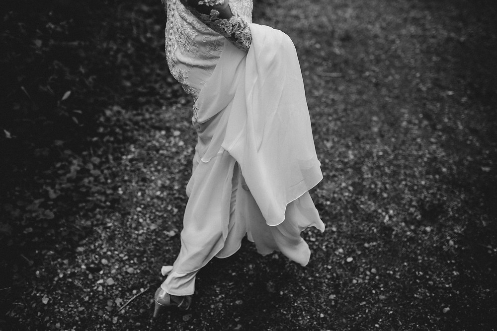 bride holding dress and running
