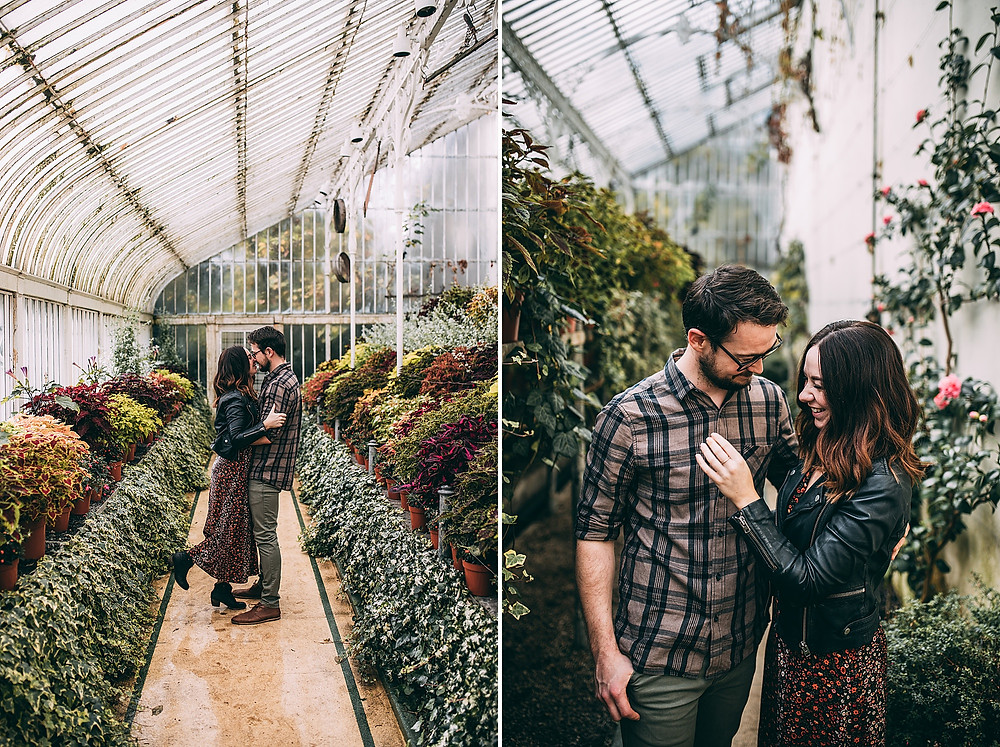 couple laughing and kissing in botanical gardens