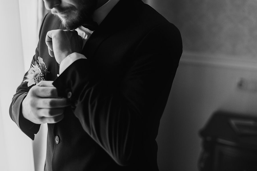 stylish-groom-silhouette-in-suit-posing-
