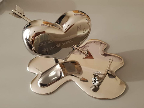 Heart and rose piece from steel in mirror finish.