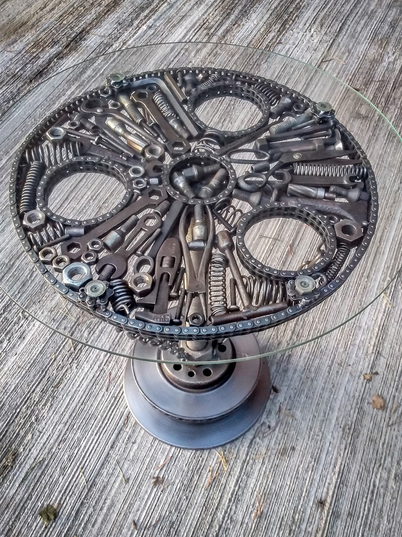 Steampunk feature coffe table with glass top