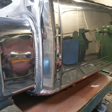 Lorry fuel tank during restoration to mirror finish