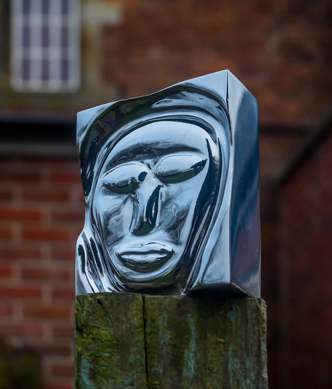 Face sculpture carved from one solid piece of steel.