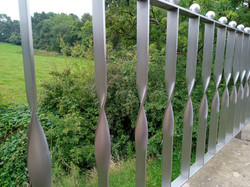Steel fence restored to satin finish