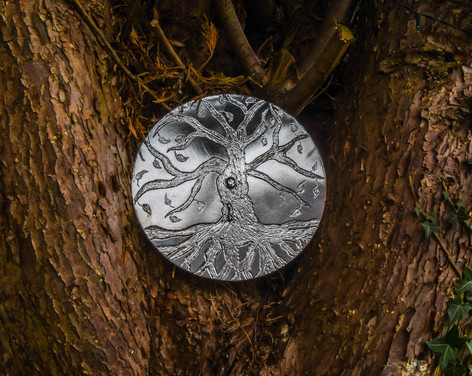 Tree of life etched on to steel plate.