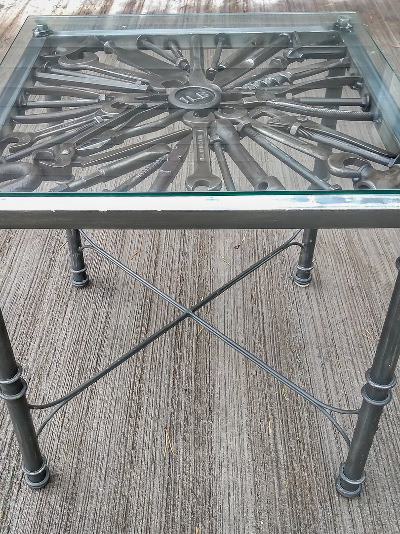 Steampunk feature table with glass top.