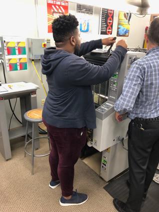 Manually ducking the printing press.