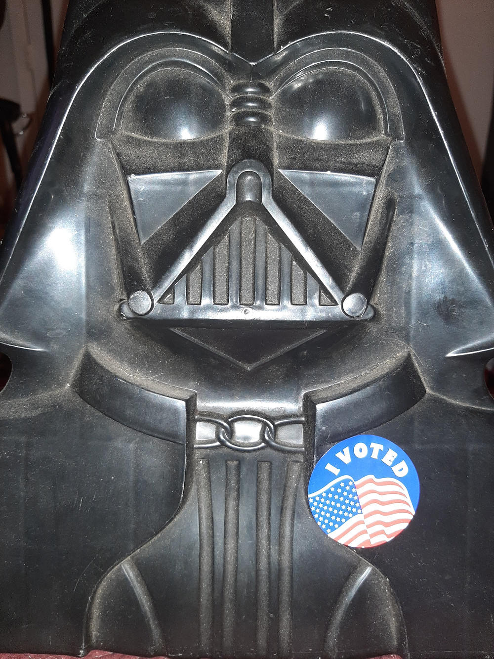 Picture of a toy Darth Vader voting