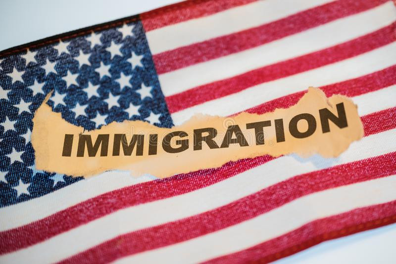 The word immigration on an American Flag