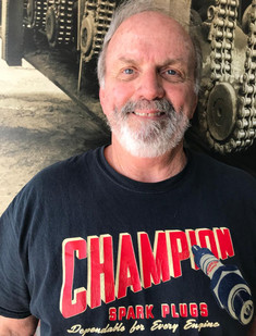 """The third pilot of our little company with over 50 years of wrenching. Heexperienced his first ride as a teenager and itnever left him.Heis a true American badass andowner of the renowned restoration shop Parts ReborninOrange. He can't wait to show you around the beautiful O.C.  """"Get after it!""""  """