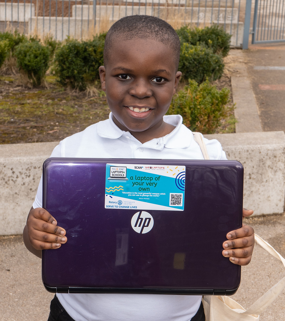 Jayden holding his laptop from Rotary Laptops4Schools