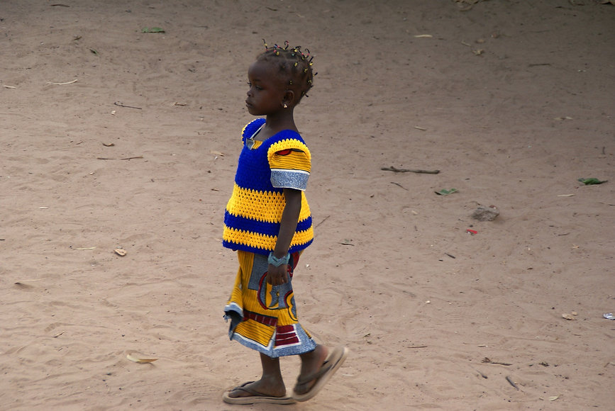 African Girl in Yellow and Blue Top