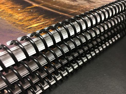 Plastic spiral binders stacked.jpg