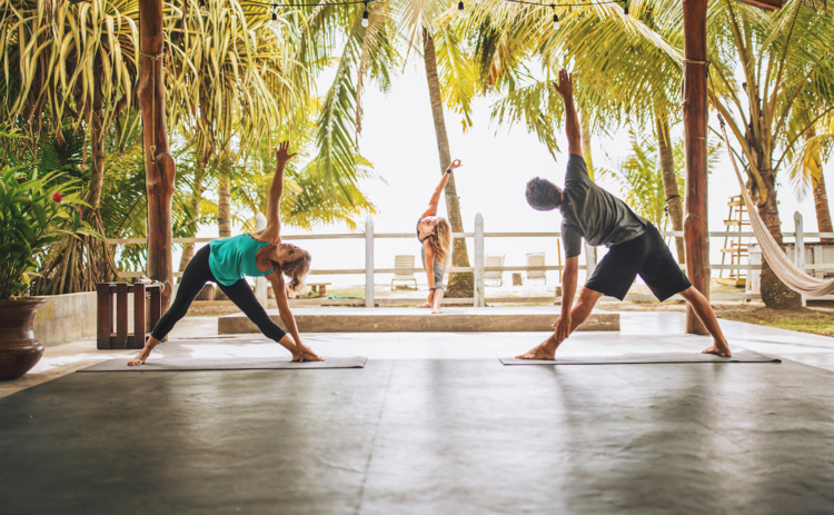yoga in the jungle while listening to the ocean waves