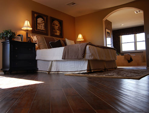 A bedroom with new flooring