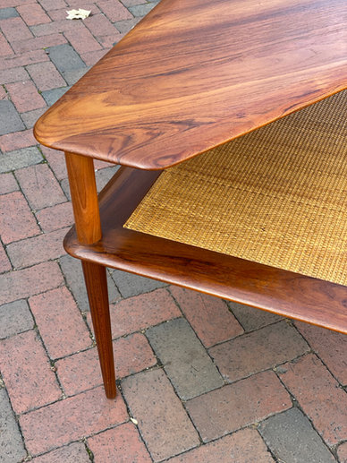 Beautifully angled refinished wood table for a midcentury modern perfect piece.