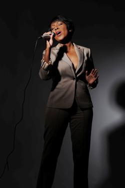 Demetria sings