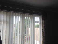 Vertical blinds.