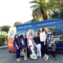 Hens party small group in front of bus.j