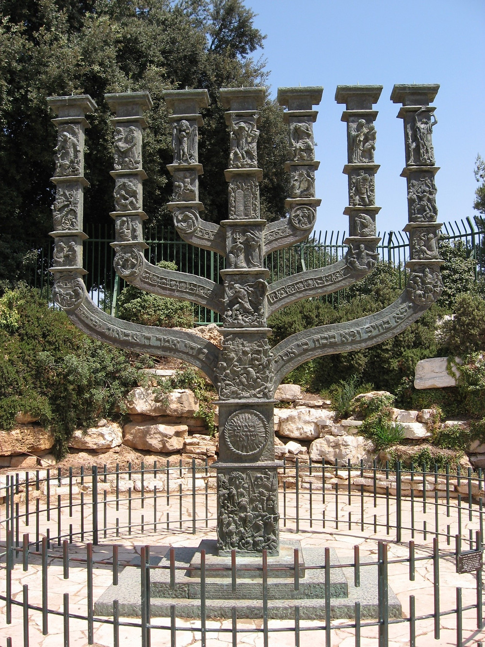 The menorah (/məˈnɔːrə/; Hebrew: מְנוֹרָה [mənoːˈɾaː]) is described in the Bible as the seven-lamp (six branches) ancient Hebrew lampstand made of pure gold and used in the portable sanctuary set up by Moses in the wilderness and later in the Temple in Jerusalem. Fresh olive oil of the purest quality was burned daily to light its lamps. The menorah has been a symbol of Judaism since ancient times and is the emblem on the coat of arms of the modern state of Israel. From Wikipedia, the free encyclopedia