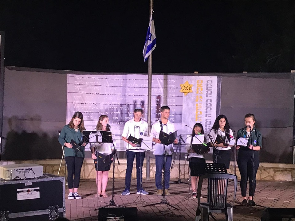 Youth from  the Reform Movement and from Bnei Akiva lead the Ceremony for Holocaust Martyrs 'and Heroes' Remembrance Day at Tzur Hadasa Israel