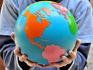 Montessori Child holding the Globe of Continents