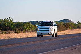 SUV truck on a country road insured by germania auto insurance specialize rural