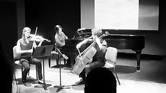 Joshua playing with a violinist and a pianist for his piano trio
