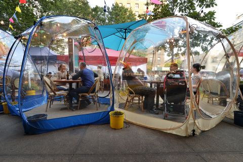 coronavirus-new-normal cafe in a bubble.
