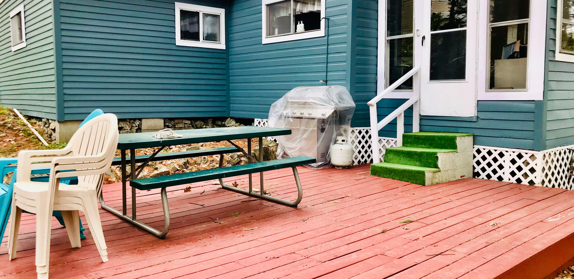Back Deck with outdoor shower, picnic table and gas grill.