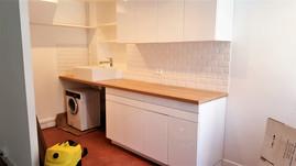 Paris 15; rénovation appartement, cuisine réhaussée sur mesure, aménagements et coffrages divers créés