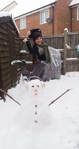 Aisha snow twirl pose