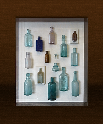 glass bottles in acrylic box