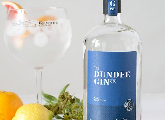 Stunning bottle of Dundee Gin classic dry served in a large copa glass with garnish